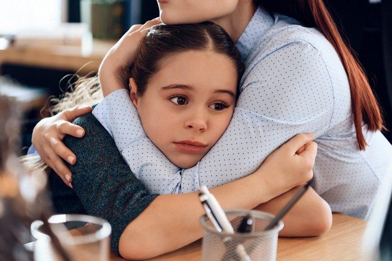 Женщина с ребенком после развода